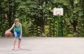 Young girl dribbling a basketball — Stock Photo