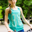 Athletic young teenage girl with a bicycle — Stock Photo #50429939