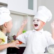 Happy little boy and girl baking in the kitchen — Stock Photo #50429963