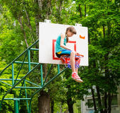 Young girl sitting in hoop — Stock Photo