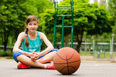 Beautiful confident young female basketball player — Stock Photo