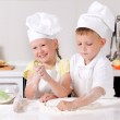 Happy little boy and girl cooking in the kitchen — Stock Photo #50430031