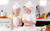 Supercilious little boy chef — Stok fotoğraf