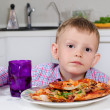 Little boy eating a big plate of pizza — Stock Photo #51009219