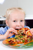 Starving young girl eating — Stock Photo