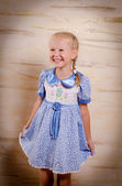 Beautiful young girl in a stylish dress — Stock Photo