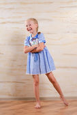 Confident beautiful young girl in a stylish dress — Stock Photo