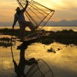 Fishermen on Inle Lake in Myanmar (burma) using unique technique of leg-rowing and conical fishnet. — Stock Photo #31311743