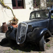 Stock Photo: Vintage car in Colonidel Sacramento street, Uruguay
