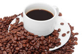 Cup of coffee with coffee beans in the background — Stock Photo