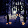 Halloween witch with pumpkin — Stock Photo