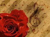 Czerwone tło muzyka róża — Zdjęcie stockowe