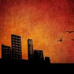 Sunset city grunge background — Stock Photo