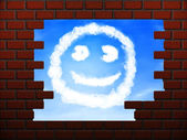 Smile cloud in hole in brick wall — Stock Photo