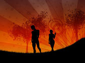 Walking at sunset — Stock Photo