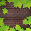 Stock Photo: Maple leaves and brick wall