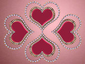Four hearts of pearls — Stock Photo
