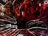 Red room through shattered glass — Stock Photo