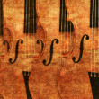 Violins in a row background — Stock Photo