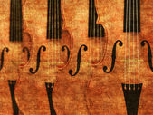Violins in a row background — Foto de Stock