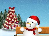 Muñeco de nieve en un banco — Foto de Stock