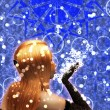 Blond girl is blowing snowflakes — Stock Photo