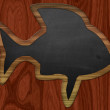 Blackboard fish on wood background — Stock Photo