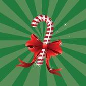 Christmas candy cane with bow — Stock Vector