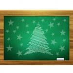 Christmas tree on green board — Stock Photo #16217781