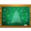 Christmas tree on green board — Stock Photo
