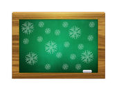 Snowflakes on green board — Stock Photo
