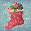 Vintage Christmas sock on blue background — Stock Photo