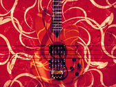 Guitar floral background — Stock Photo