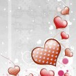 Red hearts on gray background — Stock Photo