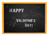 Happy valentine's day phrase on blackboard — Stock Photo