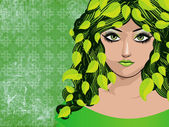 Spring girl with green leaves — Stock fotografie