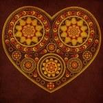 Grunge ornamental yellow heart — Stock Photo