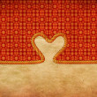 Rope heart on decorative paper — Stock Photo