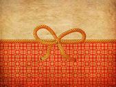 Seil-bogen auf dekorativen hintergrund — Stockfoto