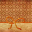 Rope bow on decorative background — Photo #21031601