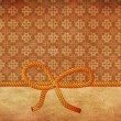 Rope bow on decorative background — Stockfoto #21031601