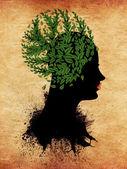 Meisje met groene bladeren — Stockfoto