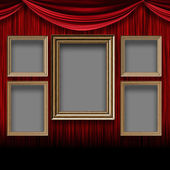 Red curtain room with wooden frames — Stock Photo