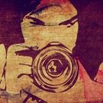 Girl photographer grunge background — Stock Photo #21780399