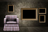 Room with armchair and wood frame — Stock Photo