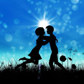 Couple silhouette on grass field — Stock Photo