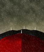 Red umbrella in the rain — Stock Photo