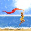 Woman jumping with scarf on beach — Stock Photo #24492475
