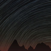 Star trails and far rocks — Stock Photo