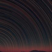 Star trails and far rocks — Stock Photo